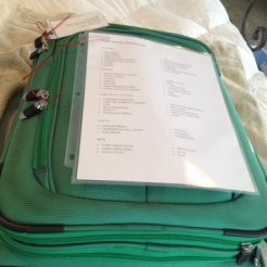 Slide a universal packing list into a sheet protector, and tie it to the outside suitcase pocket. It slips nicely into the pocket waiting for the next trip.